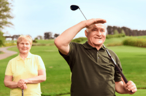 Old golfer looking into distance